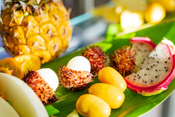 Assortment of exotic tropical fresh food background. Healthy eating, vegan and summer concept - exotic fruits. Close-up