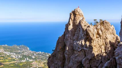 Rocks on the Mount Ai-Petri over the seaside town in Crimea, Russia
