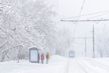 Tram goes during snowstorm in winter, Moscow, Russia