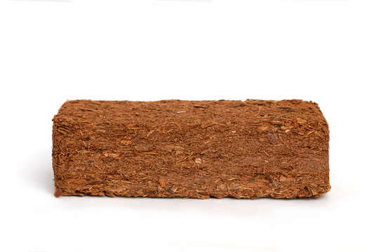 Block of Coconut Coir Husk Fiber isolated on white background