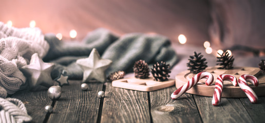 home comfort, details of the festive interior on a wooden table