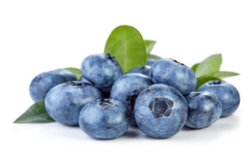 Wall Mural - heap of ripe blueberry with leaves isolated on white background