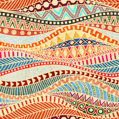 Seamless wavy pattern. Ethnic and tribal motifs. Colorful african print for textiles. Grunge texture. Ornate ornament drawn by hand. Vector illustration.