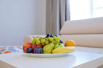 Fruit plate on white table 2