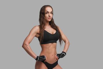Confident muscular woman in underwear