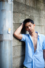 Asian male model poses for pictures on the street