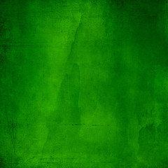 Green abstract textured background with scratches