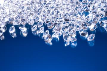 Shiny diamonds on a blue background