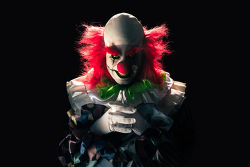 Scary clown on a dark background Wall mural