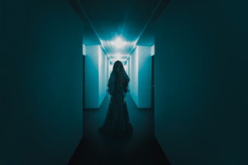 scary ghost lurking in a hallway / high contrast image