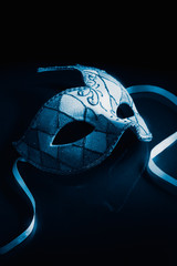 Ventetian mask on a reflective surface, high contrast image