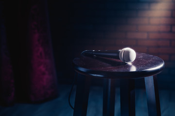 microphone on a wood stool on a stage