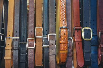 sale of belts for jeans and trousers, texture, different colors.