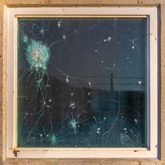 Bulletproof glass with gun shots and break