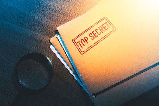 private detective desk with envelopes labeled as top secret