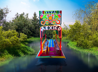 scale model replica of a mexican trajinera on the water