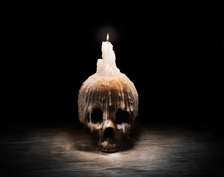 High contrast image of a skull on a table