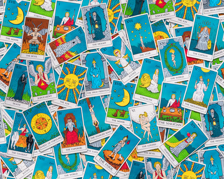 Tarot cards distributed randomly on top of each other
