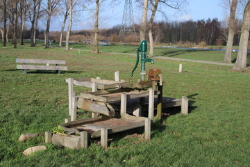 Playground with several water play tools and pull ferry over ditch in the public park Hitland in Capelle aan den IJssel in the Netherlands