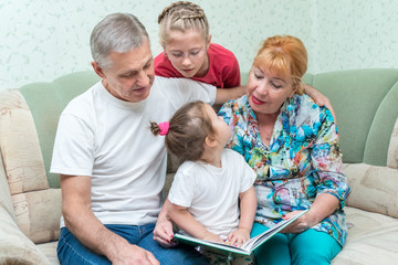 Grandmother and grandfather teach granddaughters