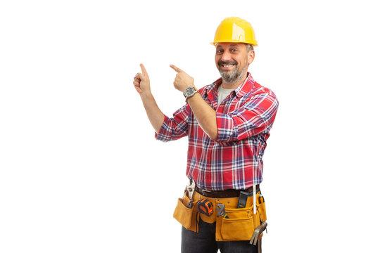 Workman pointing at blank copyspace behind.
