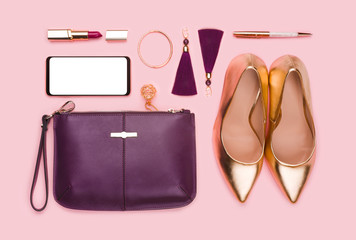 Business women set of fashion accessories isolated on pink background