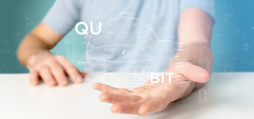 Businessman holding Quantum computing concept with qubit icon 3d rendering