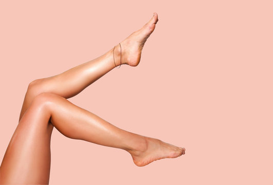 Beautiful smooth woman's legs after laser hair removal on the colorful background