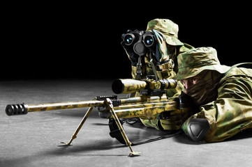 Sniper together with the gunner took the position and expect the target.