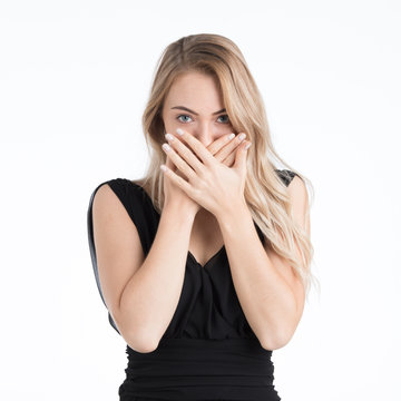 Beautiful woman covering mouth by her hands.