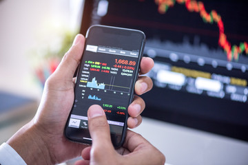 investor hands using stock market application on smartphone checking stock market price real time