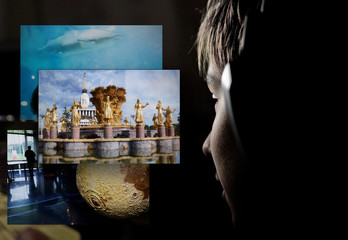 Teen boy with headphones looks at pictures for education sites. Science project concept for school education