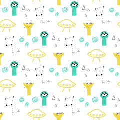 Cute and funny aliens seamless vector pattern. Yellow and mint background with stars and flying saucers.