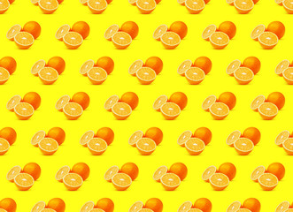 Seamless Pattern of Orange Fruits on Yellow Background. Natural Citrus Pop Art Background, High Resolution Photography