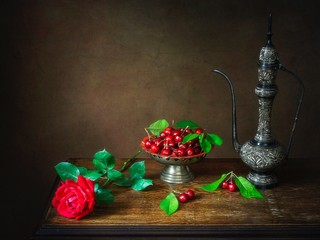 Still life with cherry and red rose