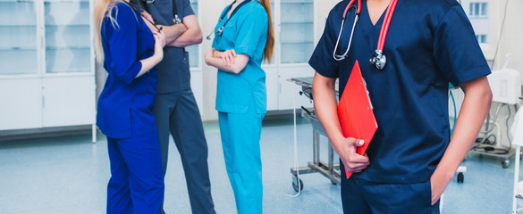 medicine professionals staff. people - doctor, nurse and surgeon. a group of faceless doctors. medical advertisement design. background wide promotional banner.