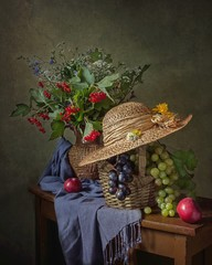 Still life with beautiful autumn bouquet and fruits