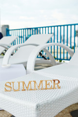Word summer on beach chair