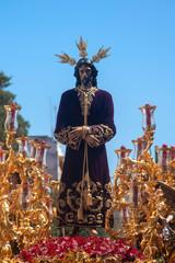 Fototapete - Jesús cautivo en la procesión de la semana santa de Sevilla
