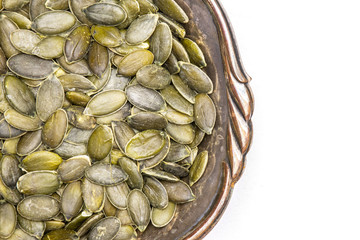 Hulled pumpkin seeds isolated on white