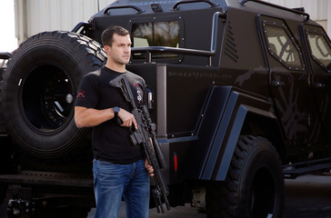 Nick Gough poses with a fully assembled .308 Roadhouse precision rifle at Spike's Tactical LLC, a gunmaker in Apopka