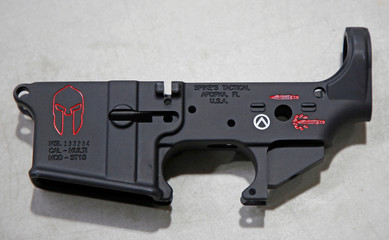 """A detailed view of of Spike's Tactical LLC's """"Spartan"""" stripped lower receiver, with shield, sword, blood sword selector markings, at the gunmaker's building in Apopka"""