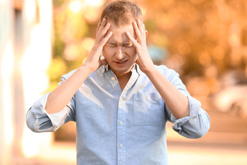 Man having panic attack outdoors