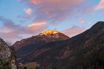 Awesome panorama of the snow-covered Orobie mountains of the Seriana Valley and the Sedornia Valley at sunset.