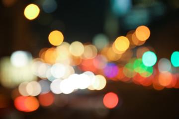 Blurred view of illuminated city at night