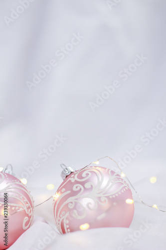 Christmas Background Portrait.Pink Christmas Balls In Front Of A White Background