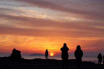The Silhouette Of People Watching The Sunset