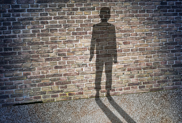 shadow on the wall of a lonely and orphan child
