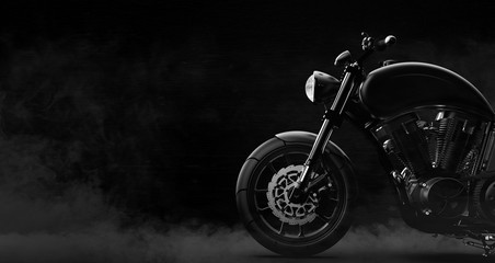 Black motorcycle detail on a dark background with smoke, side view (3D illustration) Wall mural
