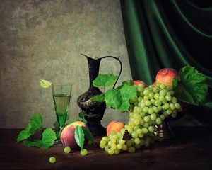 Still life with fruit and white wine